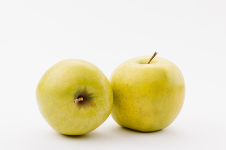 ripe golden delicious apples on white background