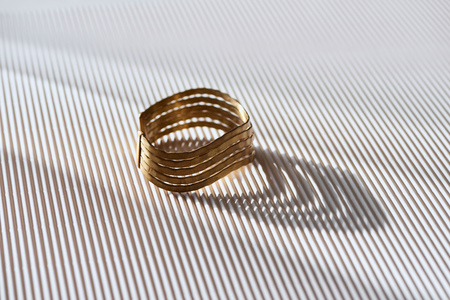 beautiful elegance ring on striped white surface with sunlight