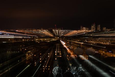 night cityscape with blurred bright illumination from windows 写真素材