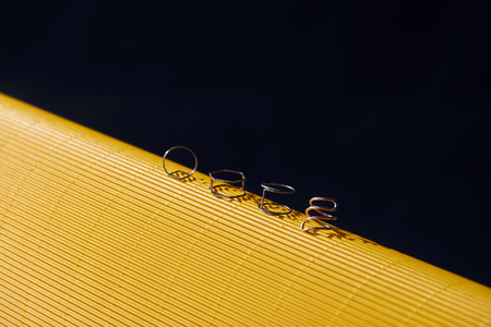 beautiful luxury rings on yellow and black striped surface Фото со стока