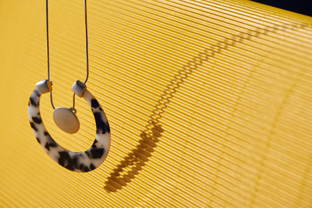 beautiful luxury necklace on yellow striped surface