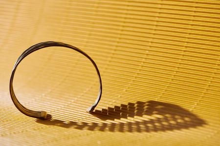 beautiful stylish bracelet on yellow striped surface