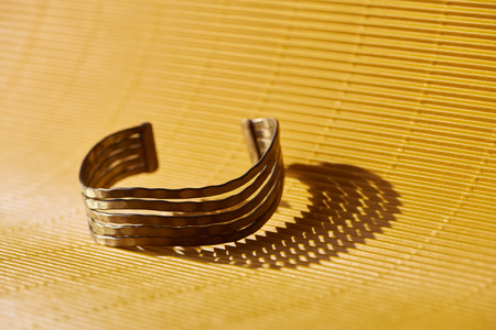 beautiful luxury bracelet on yellow striped surface
