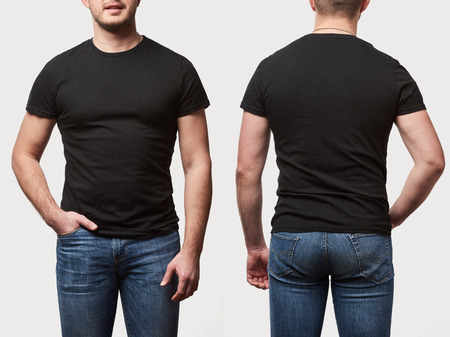 cropped view of man with hand in pocket in basic black t-shirt with copy space isolated on white Stock Photo