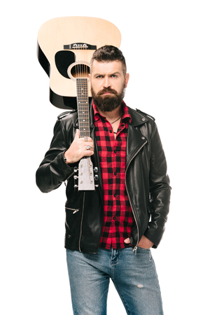handsome rocker in black leather jacket holding acoustic guitar, isolated on white