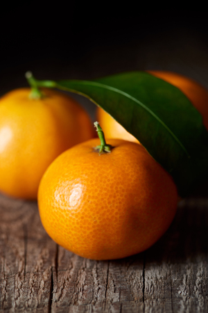 selective focus of tasty tangerines on wooden table 스톡 콘텐츠