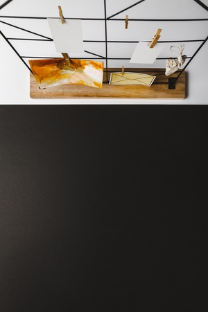 Top view of beautiful abstract painting and cards hanging on clothespins, black background Archivio Fotografico - 116386092