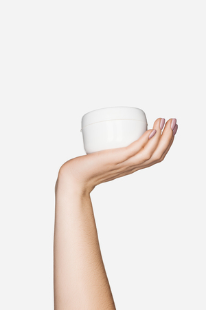cropped view of woman holding hand cream isolated on white with copy space