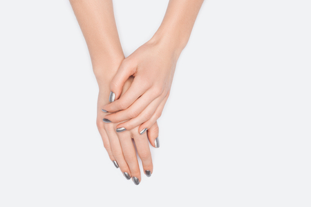 cropped view of female hands isolated on white 写真素材