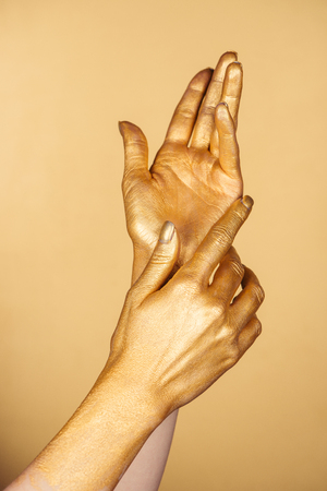 cropped view of female painted hands isolated on gold Foto de archivo - 116556672