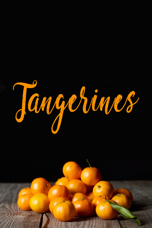 fresh tangerines with green leaf isolated on black Stock Photo