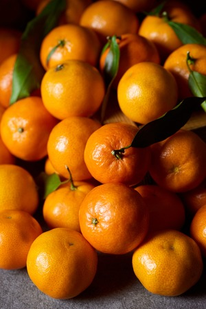selective focus of sweet orange tangerines with green leaves