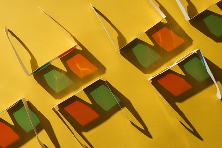 top view of 3d glasses with shadows on yellow background