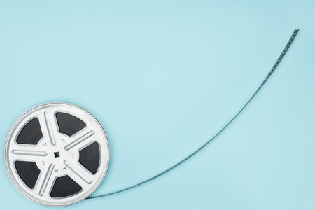 movie reel with cinema tape isolated on blue Stock Photo - 116556788
