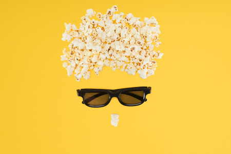 stereoscopic 3d glasses and tasty popcorn isolated on yellow Stock Photo