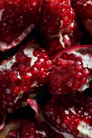 Close up shot of ripe cut pomegranates Stock Photo