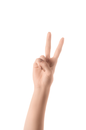 partial view of woman showing number 2 in sign language isolated on white