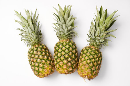 organic, juicy and sweet pineapples on white background