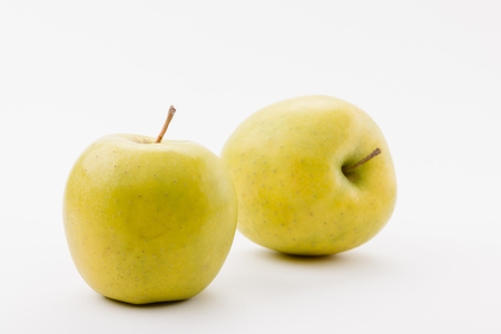 tasty golden delicious apples on white background