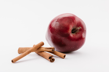 large red delicious apple and cinnamon on white background Banco de Imagens