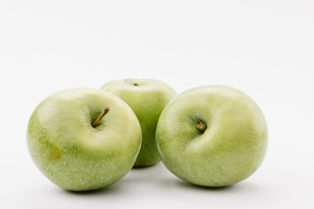 delicious large green apples on white background