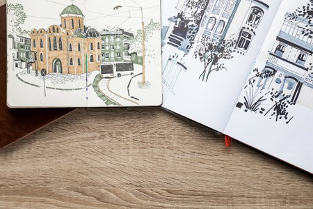top view of drawings in albums on wooden background 스톡 콘텐츠