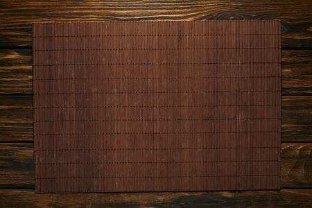 top view of empty brown bamboo mat on wooden table Stok Fotoğraf