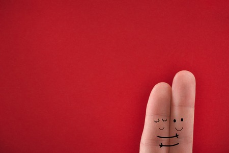 Painted fingers pretending happy couple in love hugging. Valentines day concept.