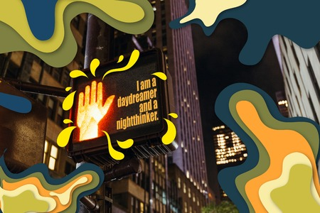 close up view of new york traffic light with i am a daydreamer and a nightthinker lettering, human hand sign and abstract illustration, usa Stock Photo