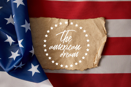vintage crumpled paper with the american dream lettering and stars on american flag