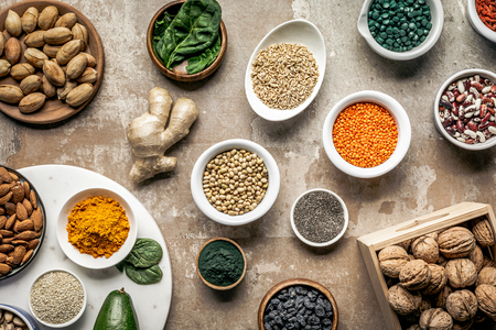 flat lay of superfoods, spices and legumes on textured rustic background Stock fotó