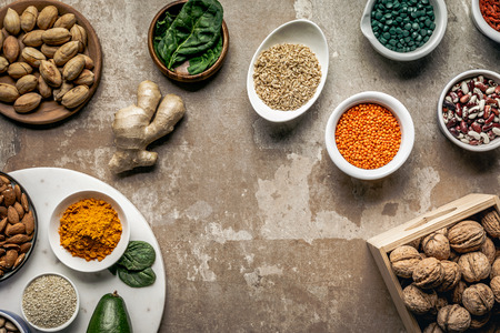 flat lay of spices, legumes, superfoods and nuts on textured rustic background with copy space Stockfoto