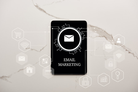 top view of digital tablet with email marketing illustration on white marble surface Stockfoto