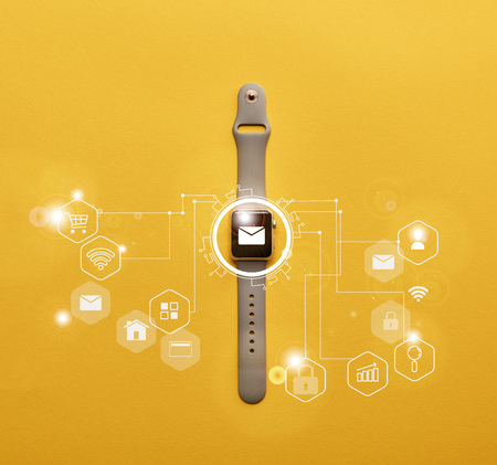top view of smartwatch with system notification on yellow surface Stock Photo