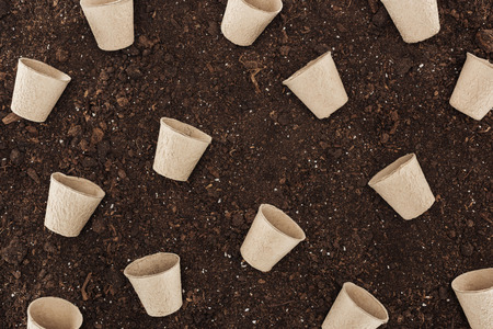top view of used paper cups on ground,  protecting nature concept