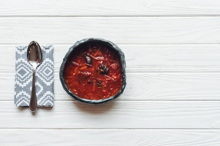 top view of traditional beetroot soup and spoon on white wooden background with copy space Banco de Imagens