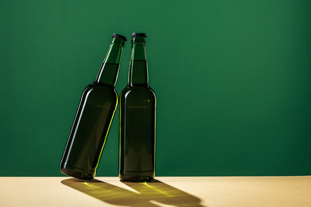 beer bottles isolated on green, st patrick day concept