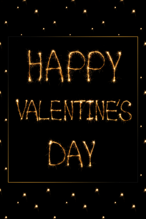 close up view of happy valentines day light lettering on black background, st valentines day concept