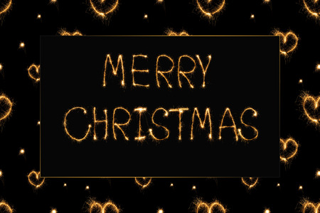 close up view of merry christmas light lettering and hearts light signs on black background Stock Photo - 116387379