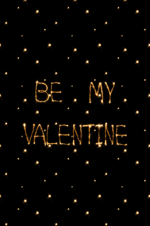 close up view of be my valentine light lettering on black background, st valentines day concept
