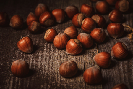 close up view of shelled hazelnuts on wooden backdrop 写真素材