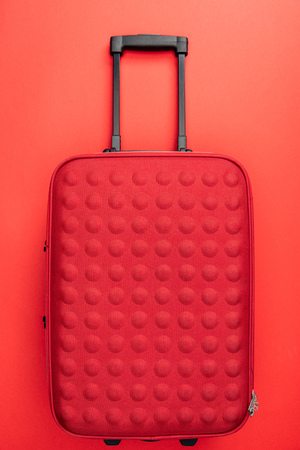 top view of travel bag on red background