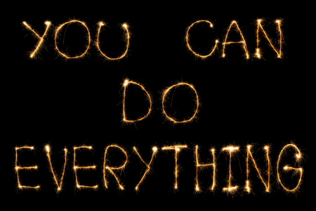 close up view of you can do everything light lettering on black backdrop Stock Photo
