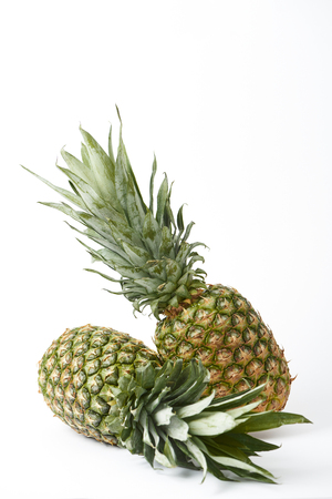 organic delicious and sweet pineapples on white background Stock Photo