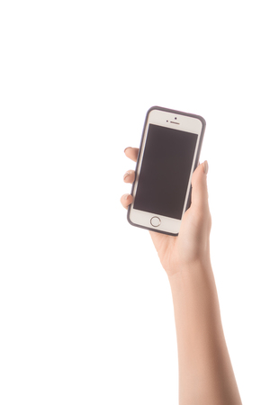 cropped view of woman presenting smartphone with blank screen isolated on white