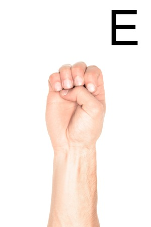 cropped view of man showing latin letter - E, deaf and dumb language, isolated on white