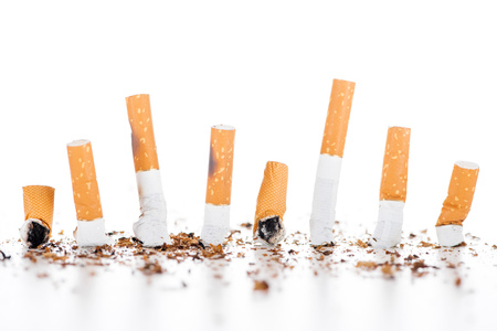 Studio shot of cigarettes and tobacco isolated on white, stop smoking concept