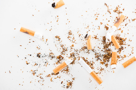 Top view of broken cigarettes isolated on white, stop smoking concept