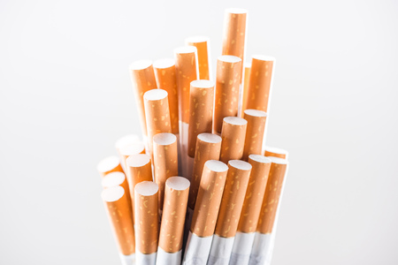 Studio shot of bunch of cigarettes isolated on white