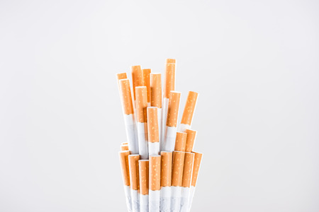 Studio shot of cigarettes with stop smoking concept isolated on grey
